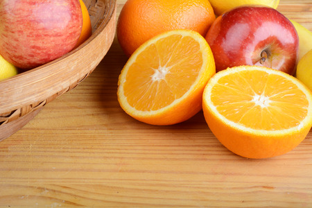 Close up of fresh fruits on wooden table.