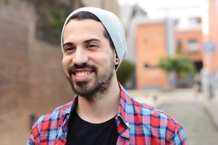 look latino: Portrait of young latin man. Urban scene. Stock Photo