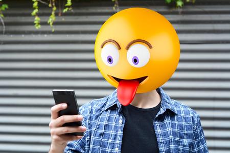 Emoji head man using a smartphone. Emoji concept