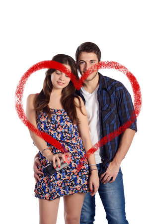 aerosol can: Portrait of a young beautiful couple drawing a heart with aerosol can. Isolated white background. Stock Photo