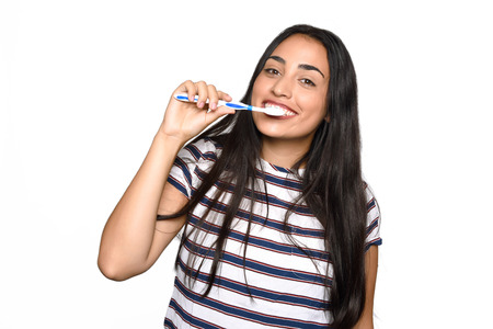 Close-up woman brushing her teeth. Isolated white background.