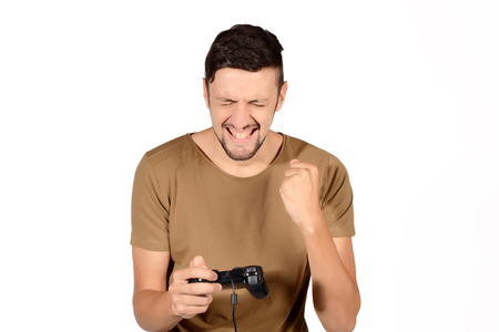 jugando videojuegos: Portrait of young man playing videogames. Isolated white background.