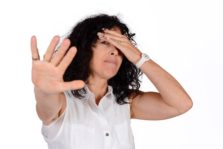 Woman doing stop gesture with hand. Isolated white background. Stock Photo