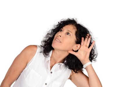 Portrait of beautiful woman hearing something. Isolated white background. Stock Photo