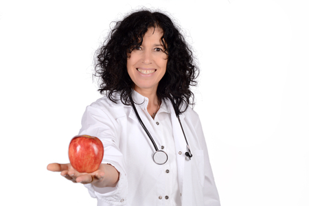 dietetics: Portrait of beautiful female doctor with an apple. Healthy concept. Isolated white background. Stock Photo