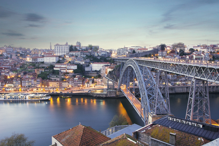 View of the sunset at the city of Porto, Dom Luis bridge and Douro river, Portugal.