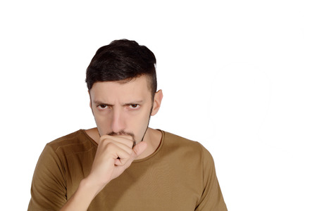 Portrait of a young man coughing. Isolated white background. Stock Photo