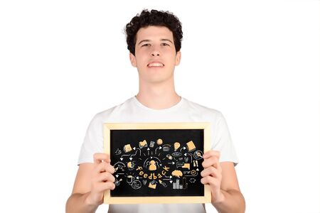 causal: Portrait of handsome young man holding chalkboard with feedback sketch. Business concept Stock Photo