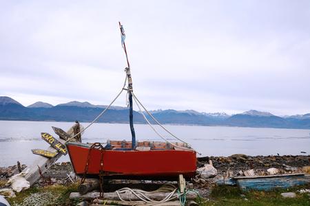 Old wooden boat abandoned ashore in Puerto Almanza, Tierra del Fuego, Argentina.