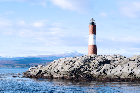 Lighthouse in the Beagle channel in Ushuaia, Tierra del Fuego, Argentina. Stock Photo