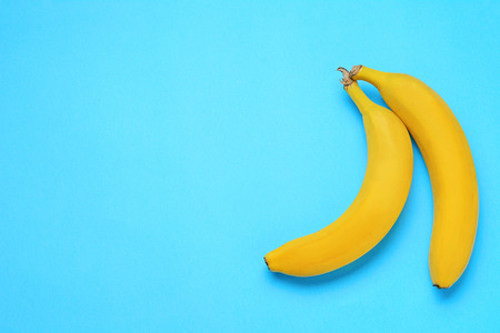 Top view. Bunch of bananas on blue background. Healty concept