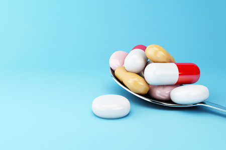 3d illustration. Spoon full of colorful pills and capsule. Pharmaceutical concept. Stock Photo