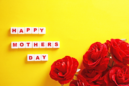 Mothers day background with hearts and red box. Yellow background