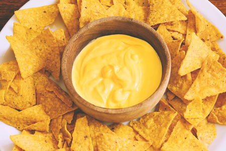 Top view of nachos with cheese dip. Unhealthy food concept Stock fotó