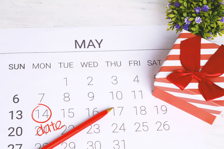 May calendar with gift box. Birthday concept.