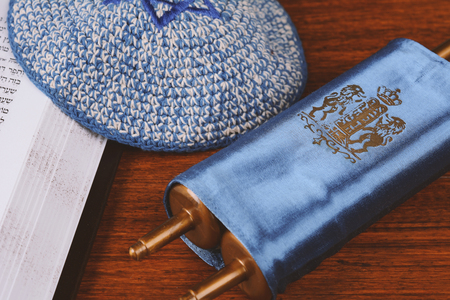 Torah with knitted kippah on wooden background. Jewish religion concept Standard-Bild
