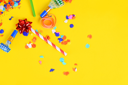 Top view of colorful party confetti background with place for text. Celebration concept