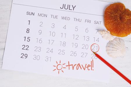 Summer Calendar Schedule with summer beach accessories. Holiday concept.