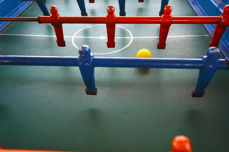 Foosball. Soccer table game, blue foosball player. Toy sport game concept.