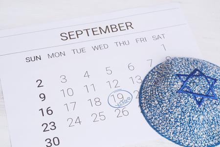 Calendar with kippah. Yom kippur concept.