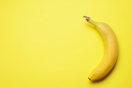 Top view. Bunch of bananas on yellow background. Healty concept Stockfoto