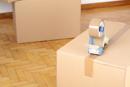 Stack of cardboard boxes in the empty room. Move concept
