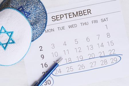 Calendar with kippah. Sukkot concept. Stock Photo
