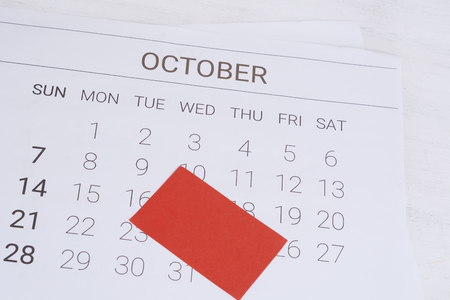 Close up view of October calendar with empty note Banco de Imagens
