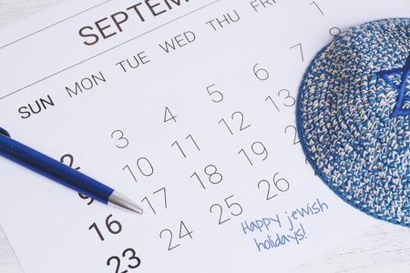 September calendar with kippah. Yom kippur concept. Stock Photo