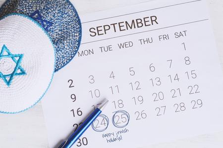 September calendar with kippah. Sukkot concept. Stock Photo