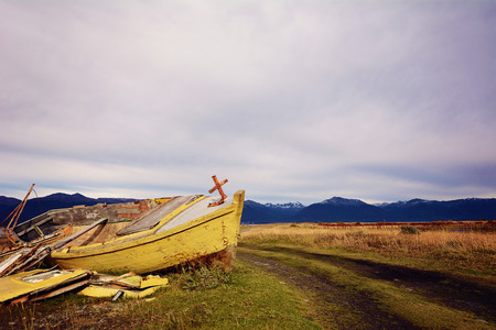 Old wooden boat abandoned ashore.