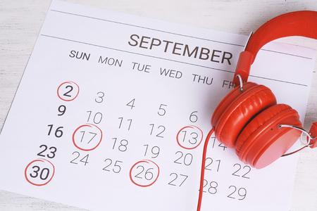 Calendar with headphones. Musical september calendar. Music and Organization management concept.