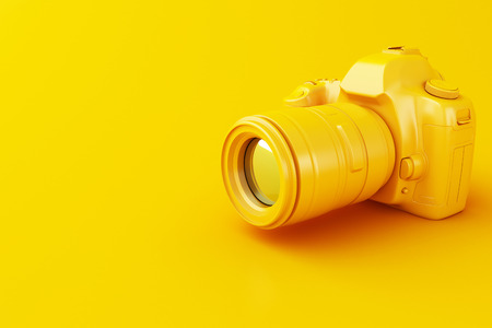3D illustration. Digital yellow photo camera on yellow background. Stock Photo