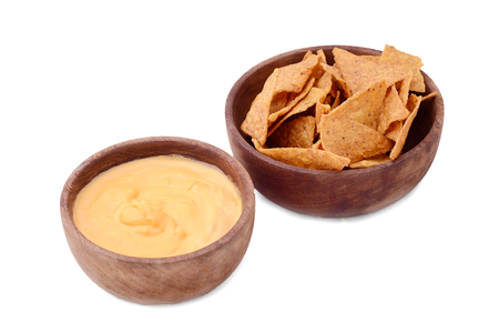 View of nachos with cheese dip. Unhealthy food concept. Isolated white background