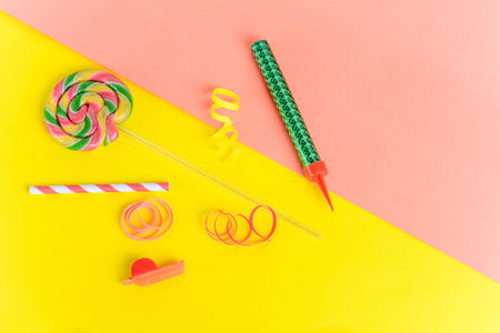 Top view of birthday party objects on colorful background. Celebration concept