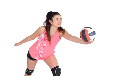 Young woman volleyball player hitting the ball. Isolated white background. 写真素材