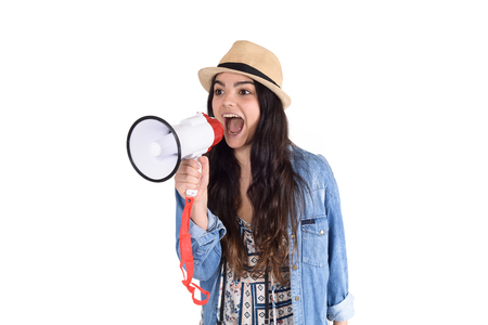 Portrait of young woman screaming on a megaphone. Marketing or sales concept.