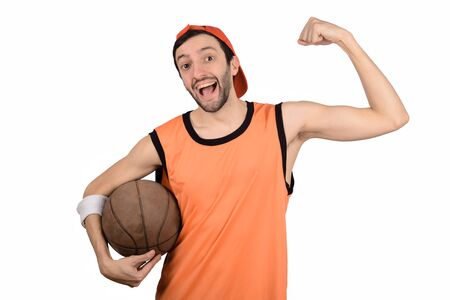 Portrait of young man with a funny expression and basketball ball. Sport concept. 写真素材