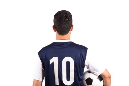 Portrait of young soccer player with soccer ball on white background. Sport concept.