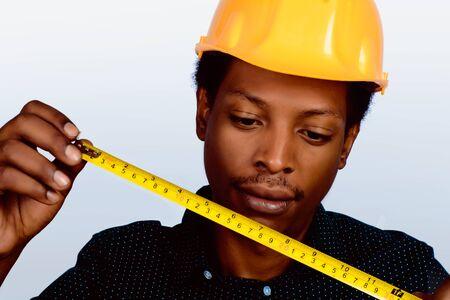 Portrait of Afro american engineer developer in hard hat on gray background. Stockfoto - 129717435