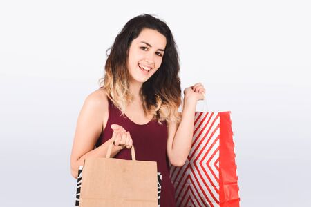 Young beautiful woman with shopping bags. Shopping, sale concept. Isolated white background. 스톡 콘텐츠 - 130136806