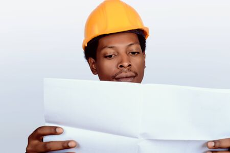 Portrait of Afro american engineer developer in hard hat on gray background. Stock fotó - 130136811