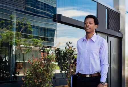 Portrait of young Afro American businessman in the city.