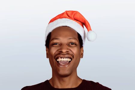 Portrait of happy american man in christmas hat. Christmas concept.