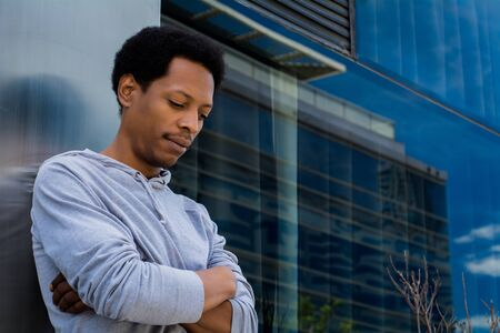Portrait of young African American man in urban background. Stockfoto