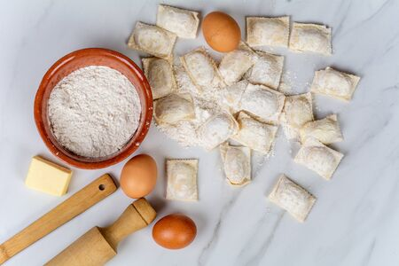 Close-up of rolling pin, cup of flour and eggs. Cooking concept Фото со стока - 130136499