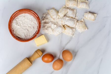 Close-up of kitchen tools, eggs, cup of flour and butter. Cooking concept.