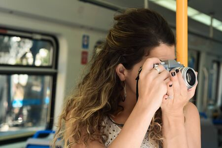 Young woman tourist traveling by the train. Enjoying travel concept.