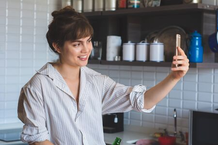 Portrait of young latin woman making a selfie at home. Stock fotó