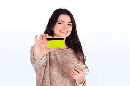 Close-up of a woman with credit card and smartphone. Shopping, sale concept. Stock fotó